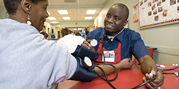 a student takes blood pressure