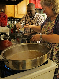UMSON faculty member Lily Fountain, PhD, RN, CNM, and Global Health Certificate student Charles Sarbeng, DNP, FNP-BC, RN, prepare a Thanksgiving meal for November INEP participants at Dr. Fountain's home.