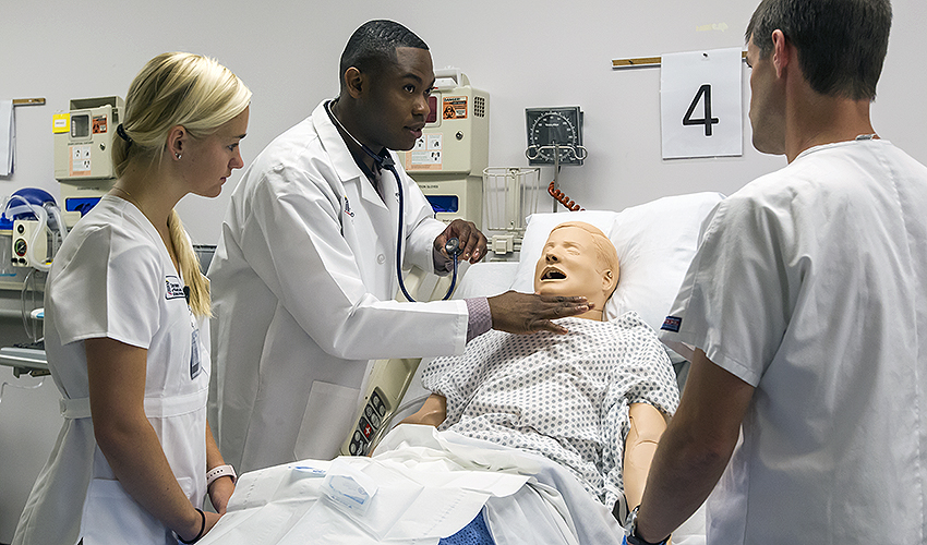 students being taught by an instructor in a simulation lab