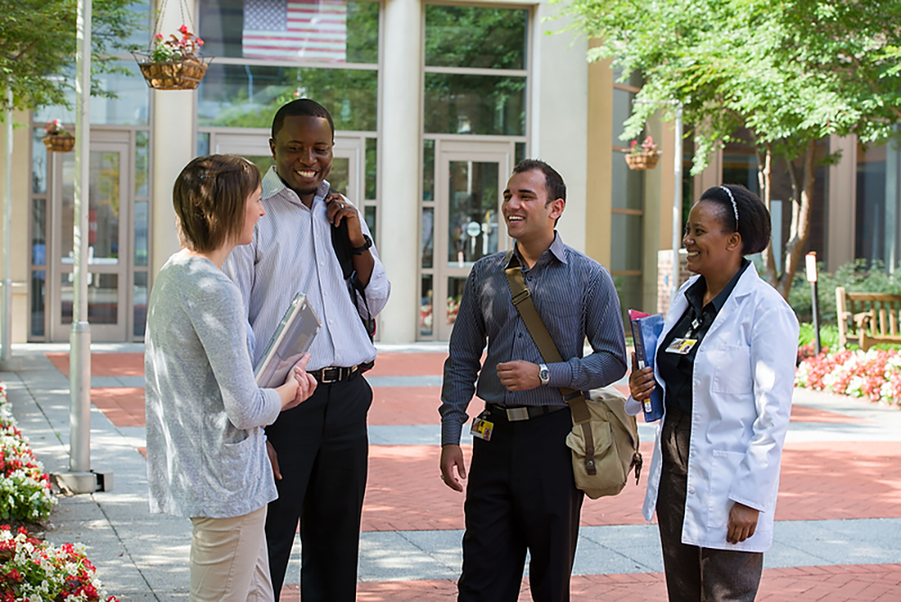 group of students talking outside the University of Maryland School of Nursing