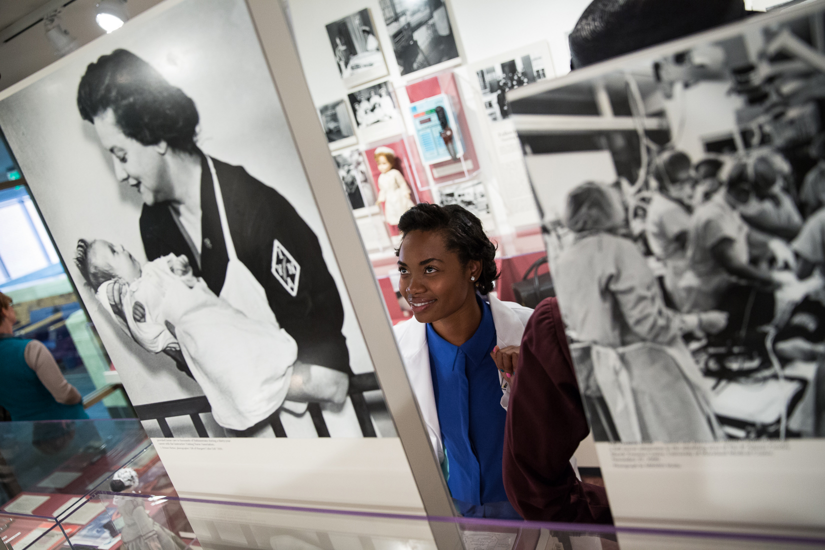 a nursing student looks at some of the items on display at the Living History Museum